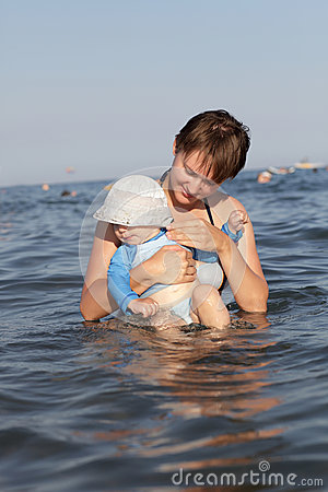 Mother with baby in sea