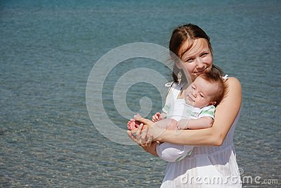 Mother and baby on sea background
