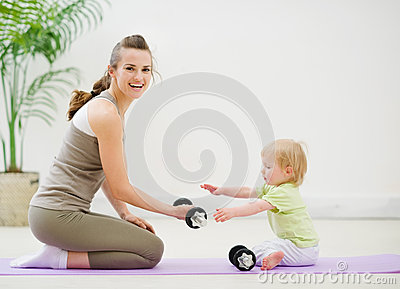 Mother and baby spending time in gym