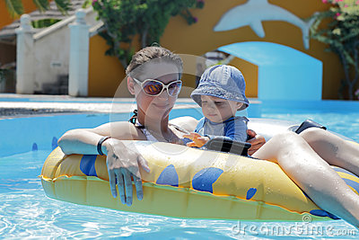 Mother with baby on swim ring