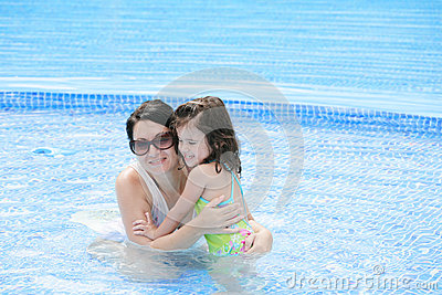 Mother and baby in the swimming pool.