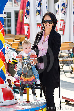 Mother and bay at funfair