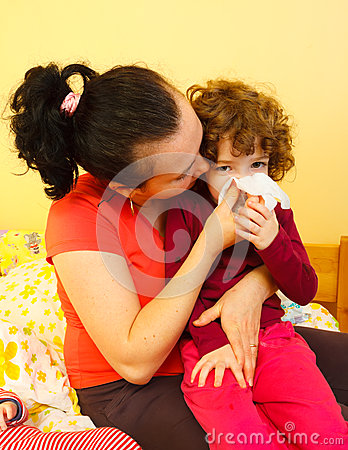 Mother blowing her child s nose