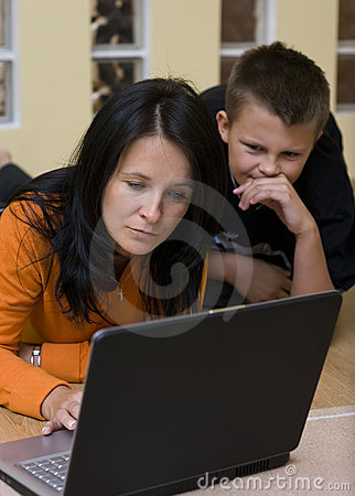 Mother and boy with laptop