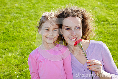 Mother with carnation and daughter