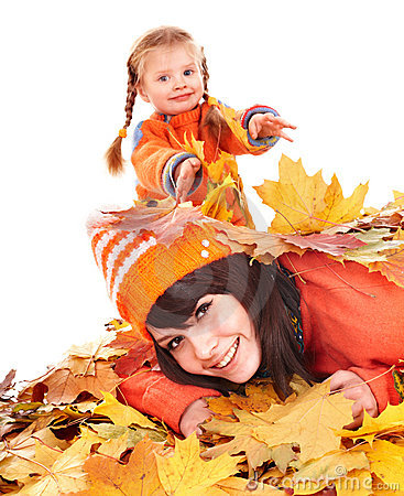 Mother with child on autumn orange leaves.