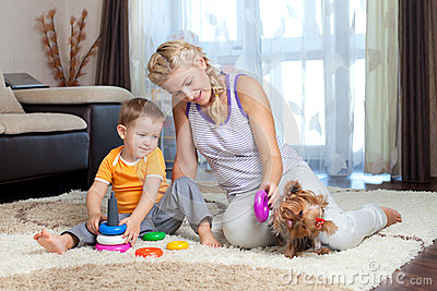 Mother, child boy and dog playing indoor