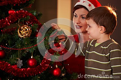 Mother and child with christmas tree