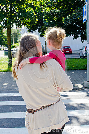Mother and child crossing the road