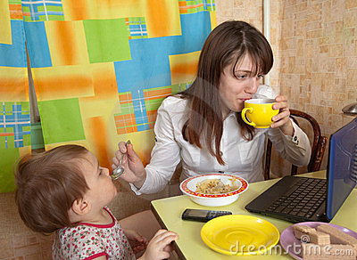 Mother and child eating breakfast