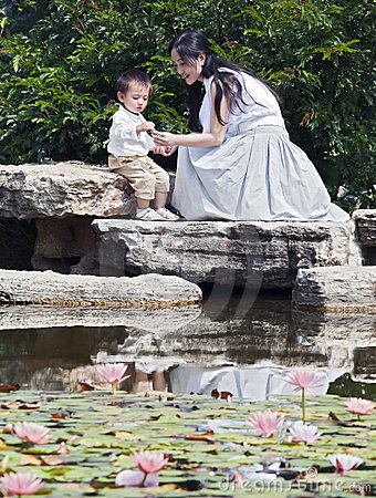 Mother and Child by lotus pond