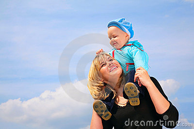 Mother with child on shoulders
