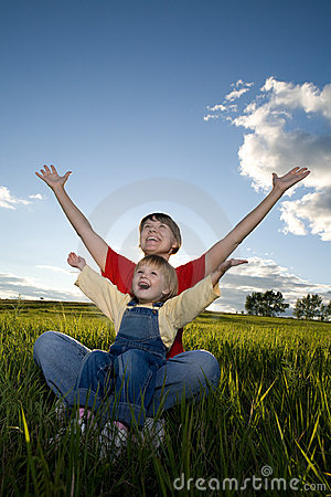 Mother and child sit in field