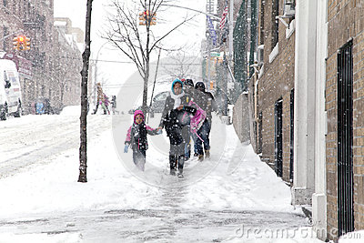 Mother and child during snow storm in New York Editorial Photo