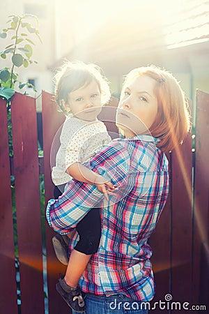 Mother child sun rays