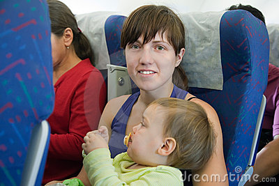 Mother and child traveling on  airliner