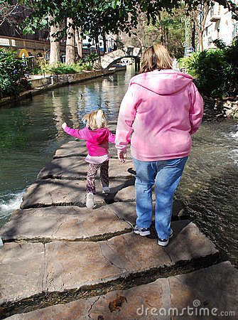 Mother and child walk along the Riverwalk