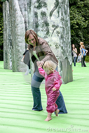 A mother and child walk on inflatable Stonehenge Editorial Stock Image