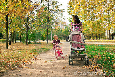 Mother with child  walking across  park