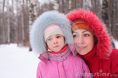 Mother with child  in winter