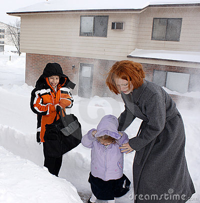 Mother And Children In Blizzard