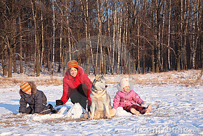 Mother with children and dog in winter