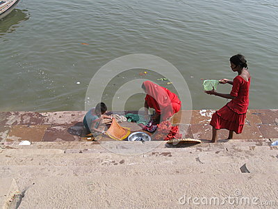Mother and children doing laundry Assi Ghat Varanasi India