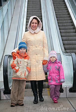 Mother and children at escalator
