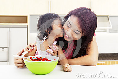 Mother And Children In Kitchen Royalty Free Stock Photography - Image: 25508877