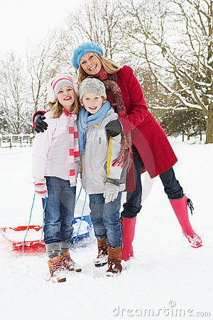 Mother and Children Pulling Sledge Through Snow