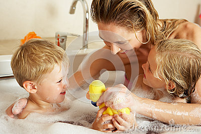 Mother With Children Relaxing In Bath