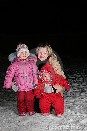 Mother with children on snow