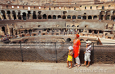 Mother and children, standing in Coliseum