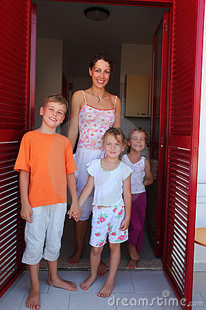 Mother with children standing in doors