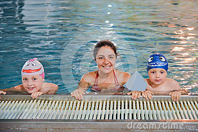 Mother and children at the swimming pool