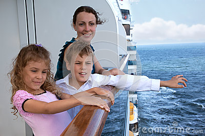 Mother with children travel on ship