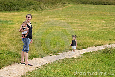 Mother with children walking outdoors