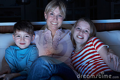 Mother And Children Watching Programme On TV  Tog