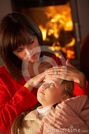 Mother Comforting Sick Daughter