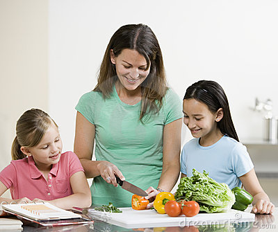 Mother cook with Daughters