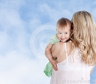 Mother with cute baby girl looking over shoulder
