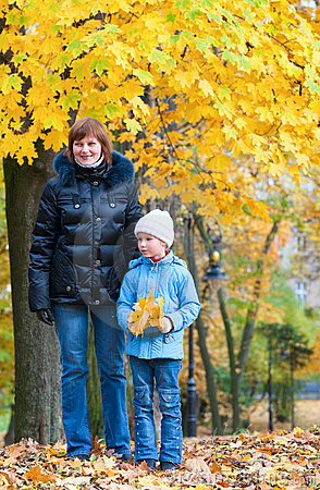 Mother with daughter in autumn city park