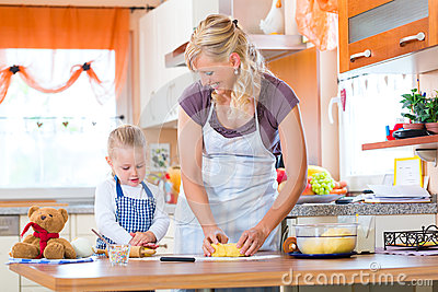 Mother and daughter baking cookies together