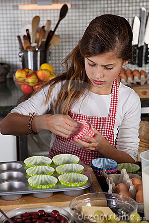 Mother and daughter baking at home