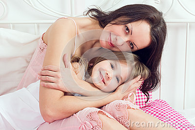Mother and daughter on bed