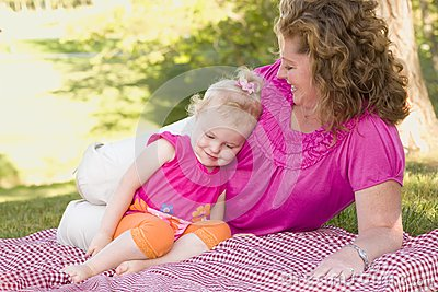 Mother and Daughter on Blanket in the Park