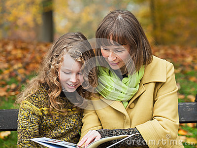Mother and daughter with a book
