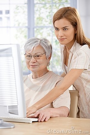 Mother and daughter browsing internet