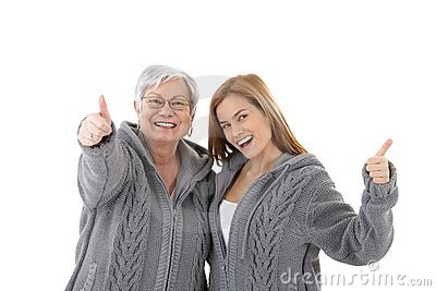Mother and daughter celebrating success smiling