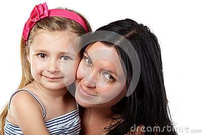 Mother and daughter cheek to cheek